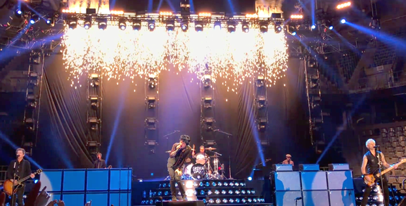 Green Day performing in Germany in 2017. (L. to r.) Jason White, Jeff Matika, Billie Joe Armstrong, Tré Cool, Jason Freese, and Mike Dirnt. (photo: Alvaranstrong and Wikipedia)