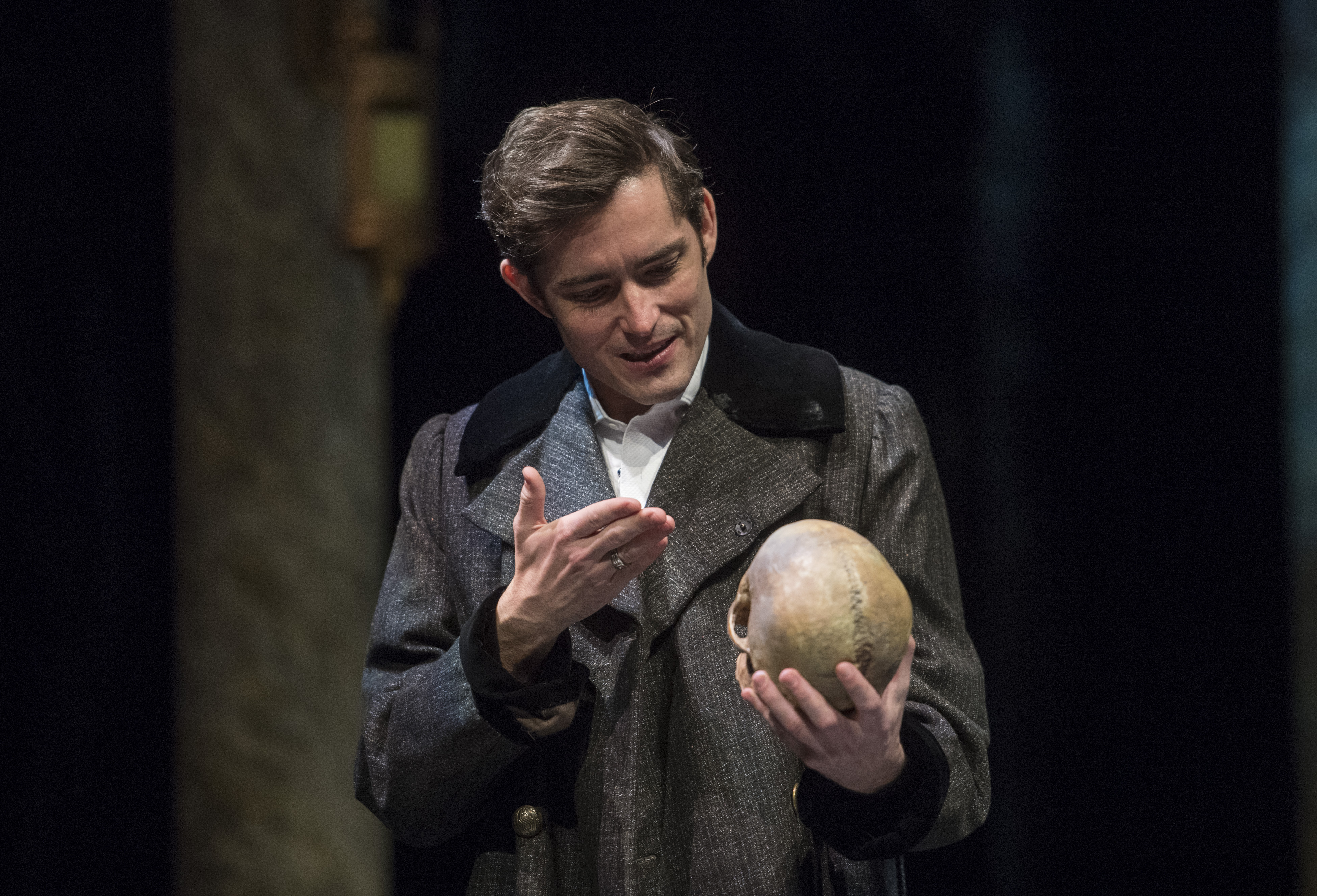Hamlet (Matthew Amendt) finds the skull of Yorick, the jester who amused him when he was a child. Photo: Michael Henninger.