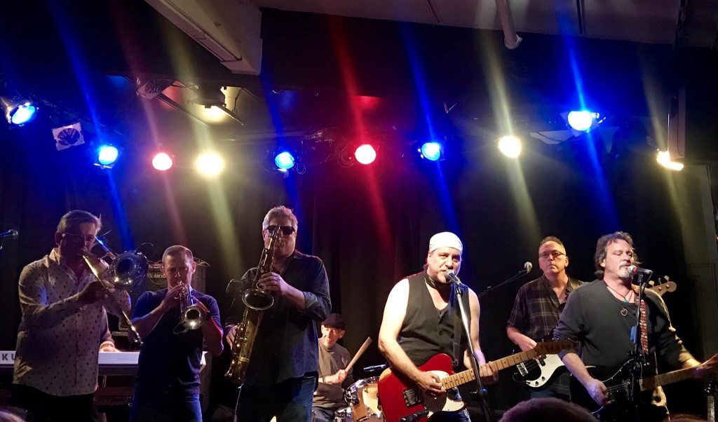 Bill Toms (center) and Hard Rain with The Soulville Horns performing at Club Cafe.