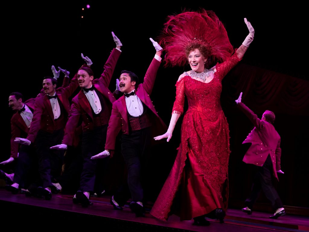 "Dolly singing and dancing with the waiters in the ""Hello Dolly!"" number from the musical. Photo Credit: Julieta Cervantes"