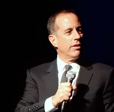 Jerry Seinfeld at the mic in 2016. (photo: slgckgc and Wikipedia)