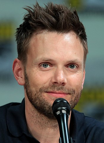 Joel McHale speaking at the 2014 San Diego Comic Con. Photo by Gage Skidmore and Wikipedia.