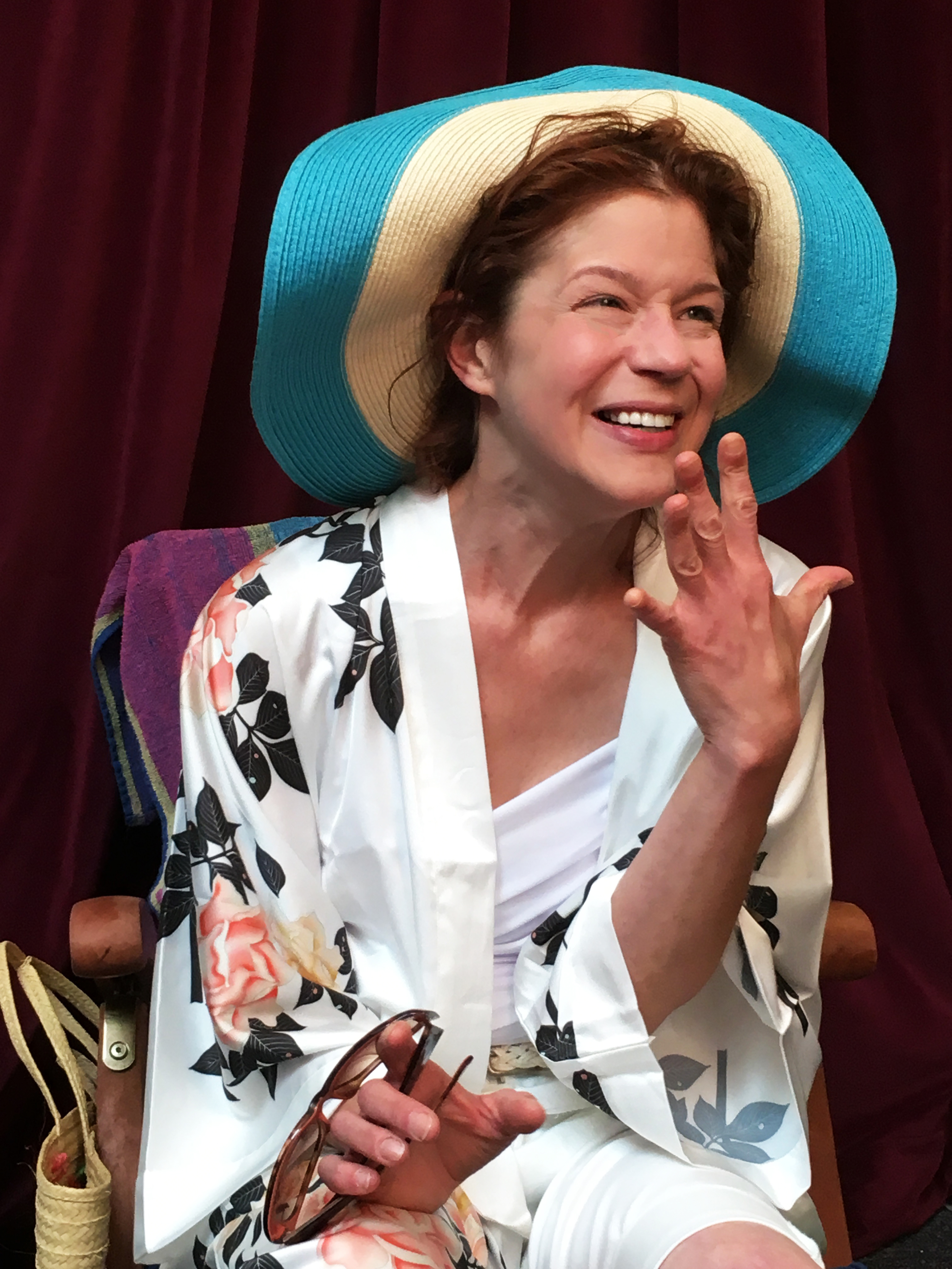 """The hat, the hat! Clad in crowning glory, lonesome Shirley (Karen Baum) sees brighter days ahead in PICT's """"Shirley Valentine."""""""