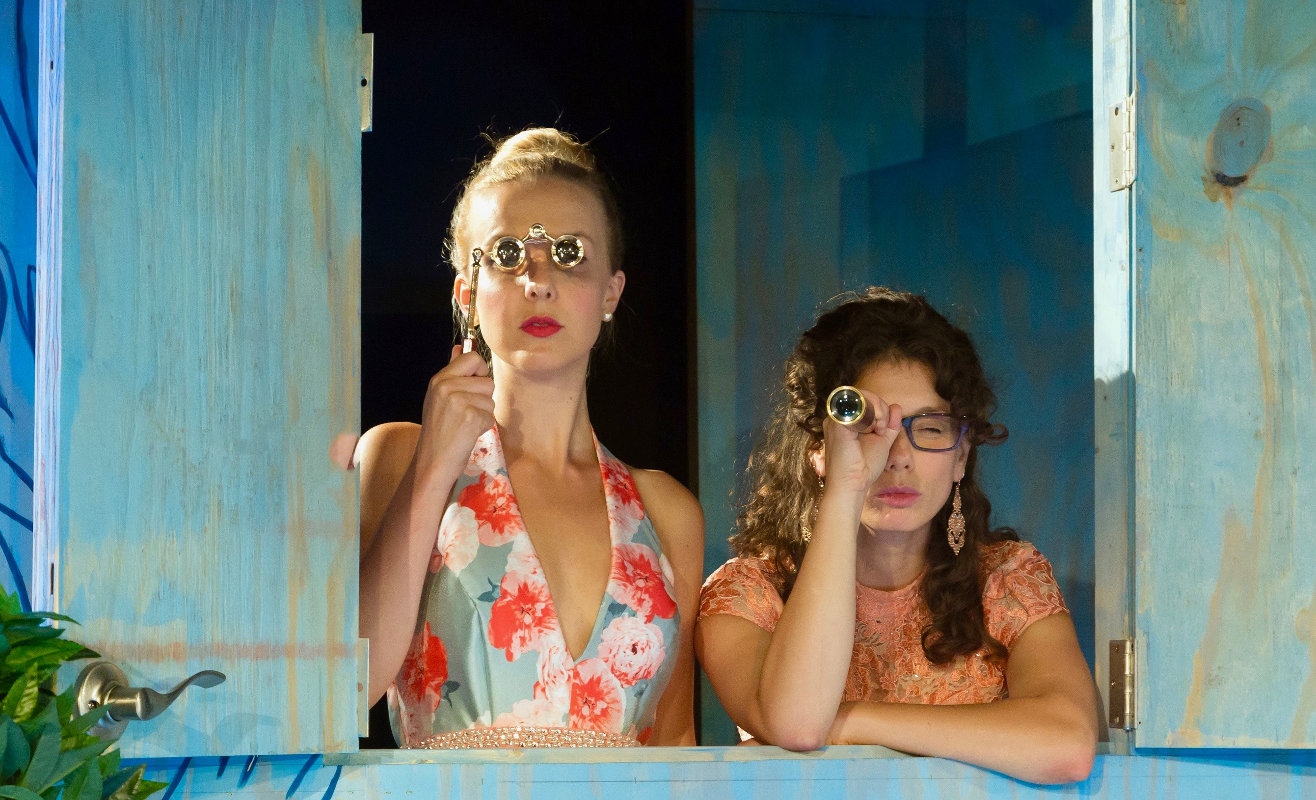 Sharp-eyed Clarice (Erika Strasburg, L) and Lucrece (Sarah Silk) use spyware to monitor the dubious doings of Dorante.