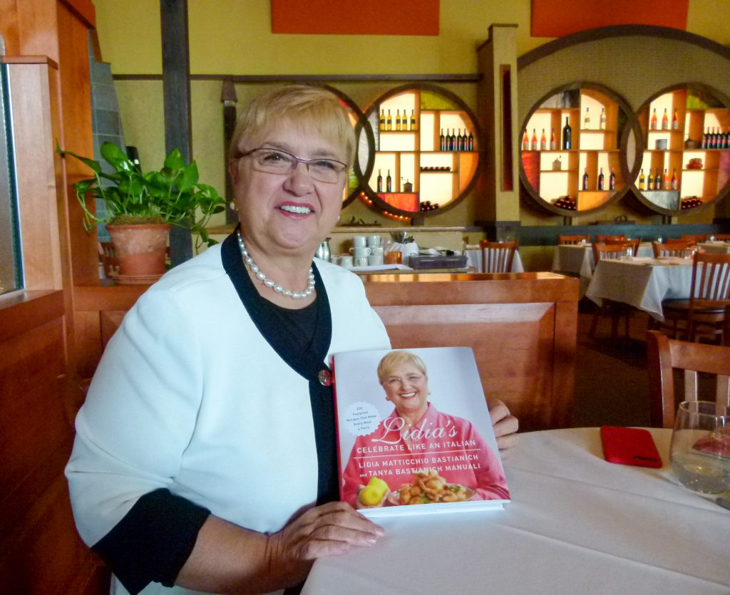 Lidia proudly shows her latest cookbook, 'Celebrate Like an Italian.'