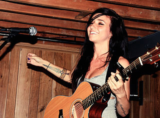 Lights (Valerie Poxleitner) performing an acoustic set in Toronto at Sonic Boom record store in 2010. Photo: Shandi-lee Cox and Wikipedia.
