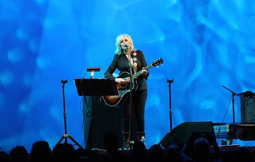 Lucinda Williams performing outdoors at Lincoln Center in New York City in 2016. (photo: Didier Moïse and Wikipedia)