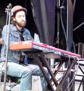 Jesse Siebenberg performing on the keyboards.