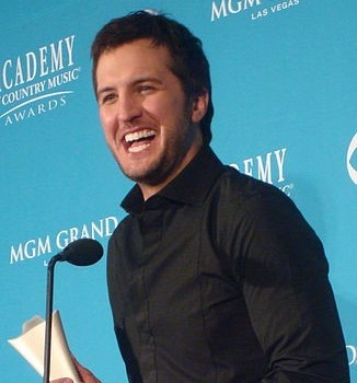 Luke Bryan accepting an award from the Academy of Country Music. photo: Keith Hinkle, w.c.c.