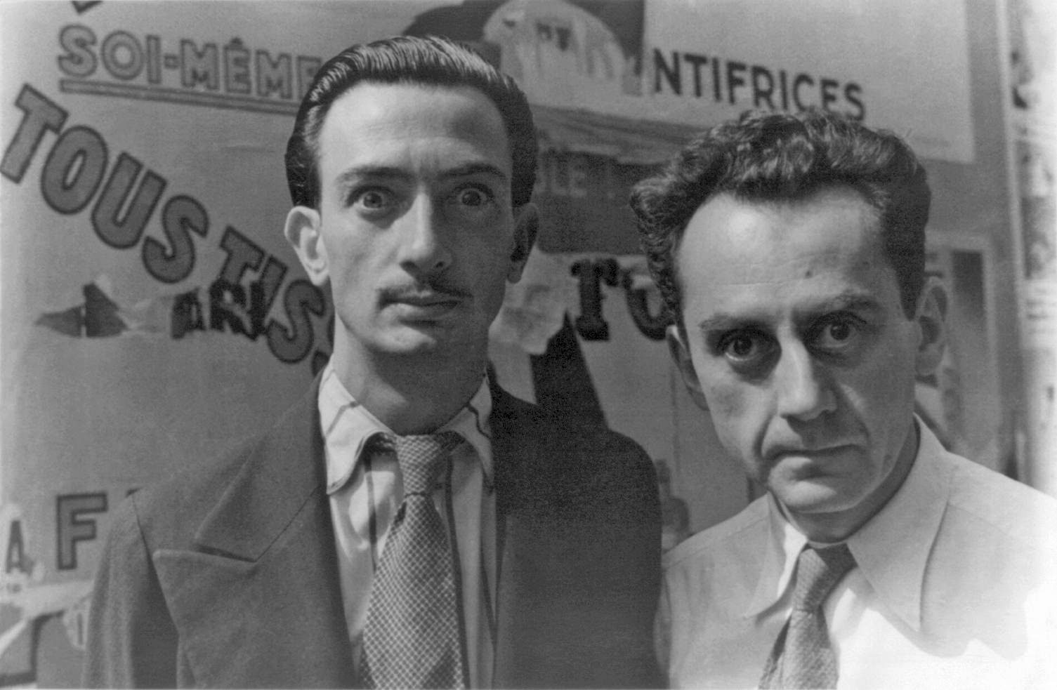 Not included in The Frick's show, this snapshot captures two of the many foreign-born artists who frequented Paris between the World Wars. The shorter, intense guy on the right is Man Ray. On the left, his fellow surrealist Salvador Dali. (Photo by Carl Van Vechten, 1934)