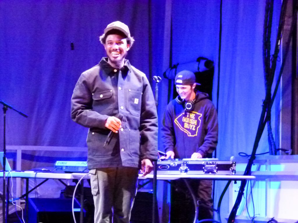 DJ Spillz and Jackson share a light moment with the audience.