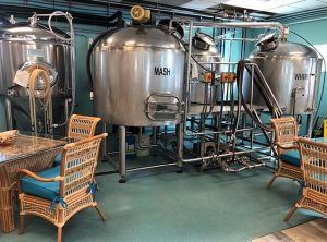 Patrons can admire the brewing tanks inside the restaurant.