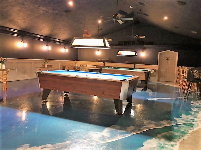 The Ocean Room features pool tables and a floor that resembles a beach.