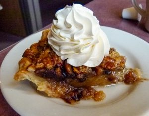 Blueberry pecan pie with whipped cream.