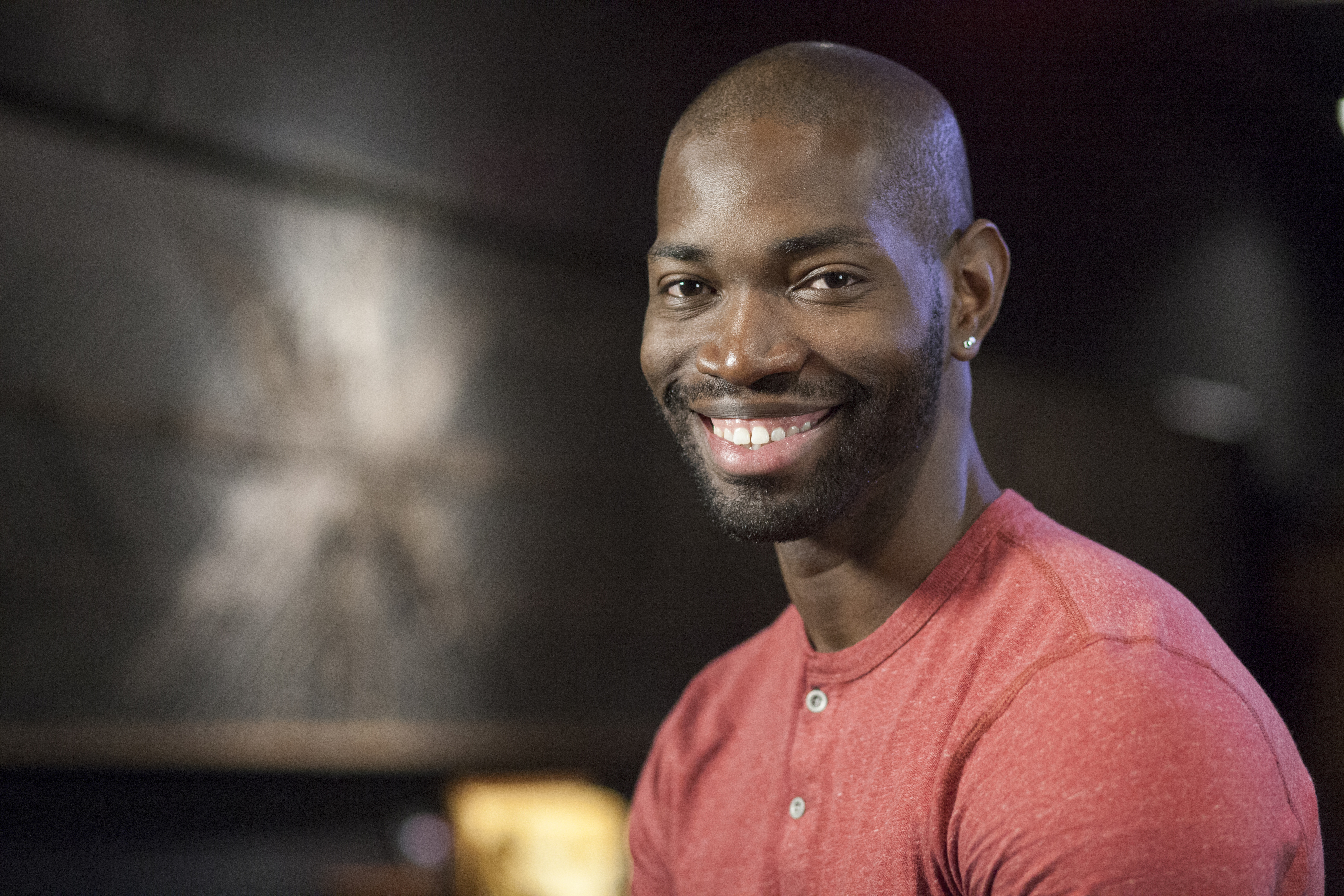 """The man with the million-dollar smile is playwright Tarell McCraney, shown here in his official portrait as a MacArthur Foundation """"Genius Grant"""" winner. """"Wig Out!"""" is one of the plays that helped earn him the award."""