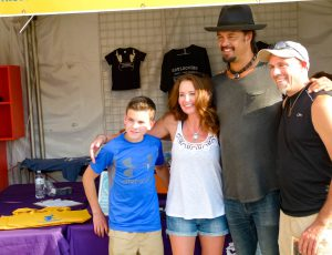 Michael Franti poses with some fans for a photo before the concert.