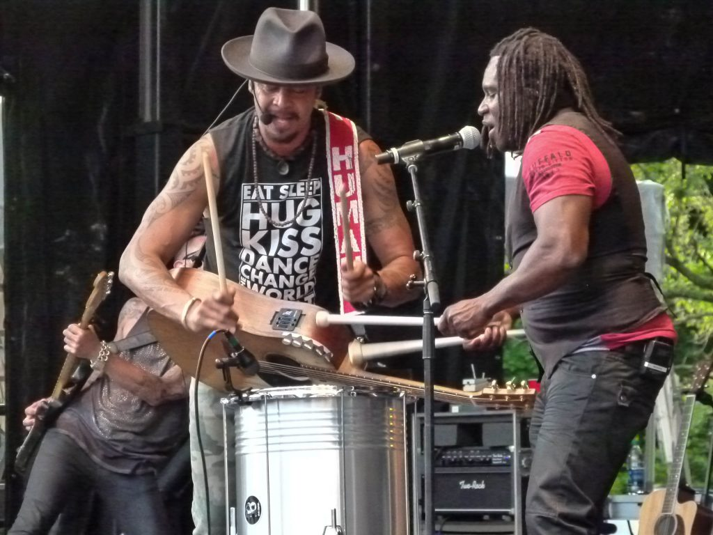 Drummer Manas Itiene teams up with Franti on an upright drum.