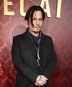 Posing at the film's premiere, Depp looked as if handcuffed for a perp walk. But should he walk the plank for this offense?