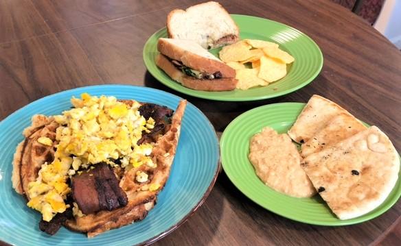 A waffle sandwich, a turkey sandwich, and a hummus platter showcase Mr. Smalls' variety.