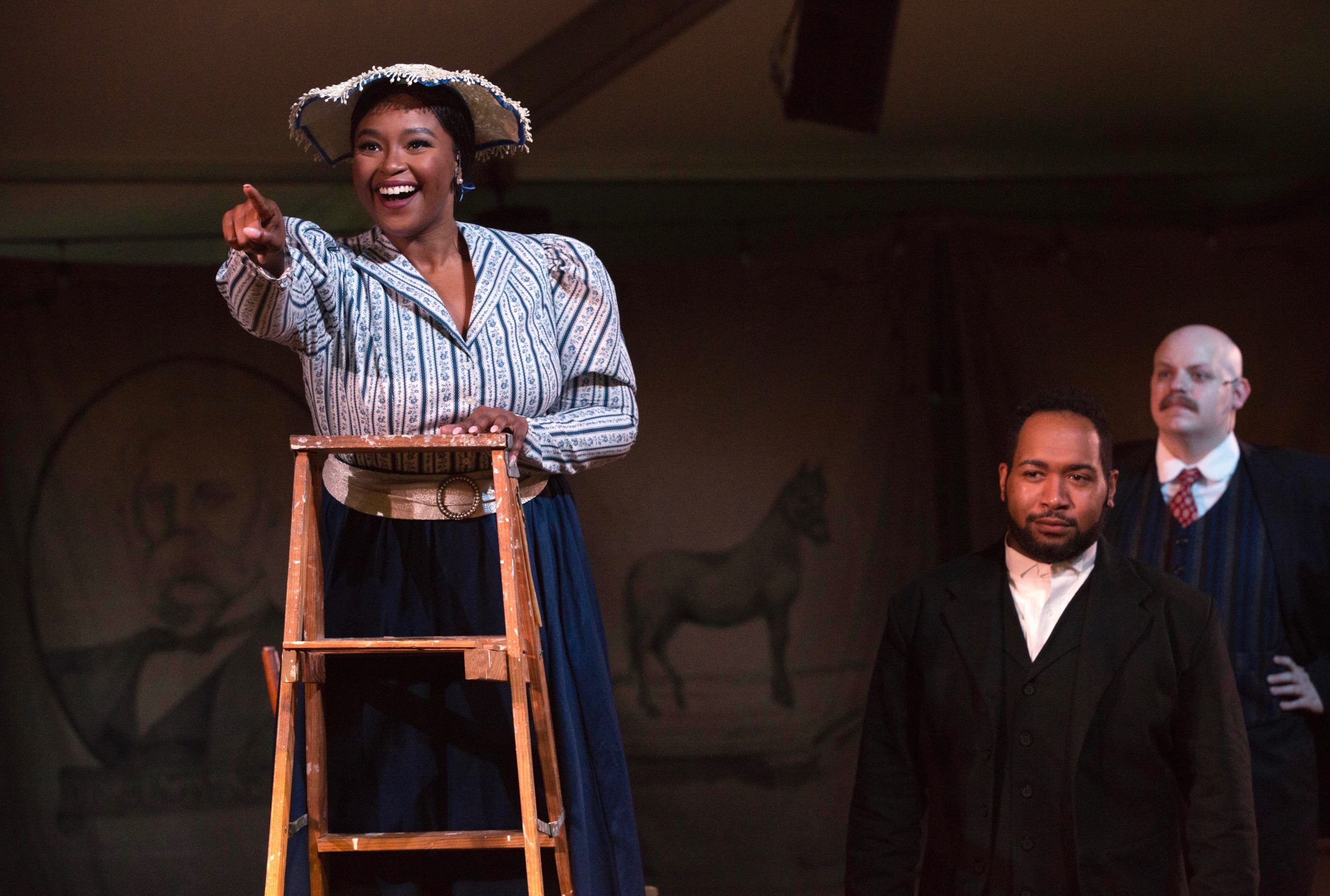 Marguerite Westinghouse (Melessie Clark) beholds the bright magic of a town lighted by AC. Husband George knew it would work and so, apparently, did his colleague Franklin Pope (Connor McCanlus).