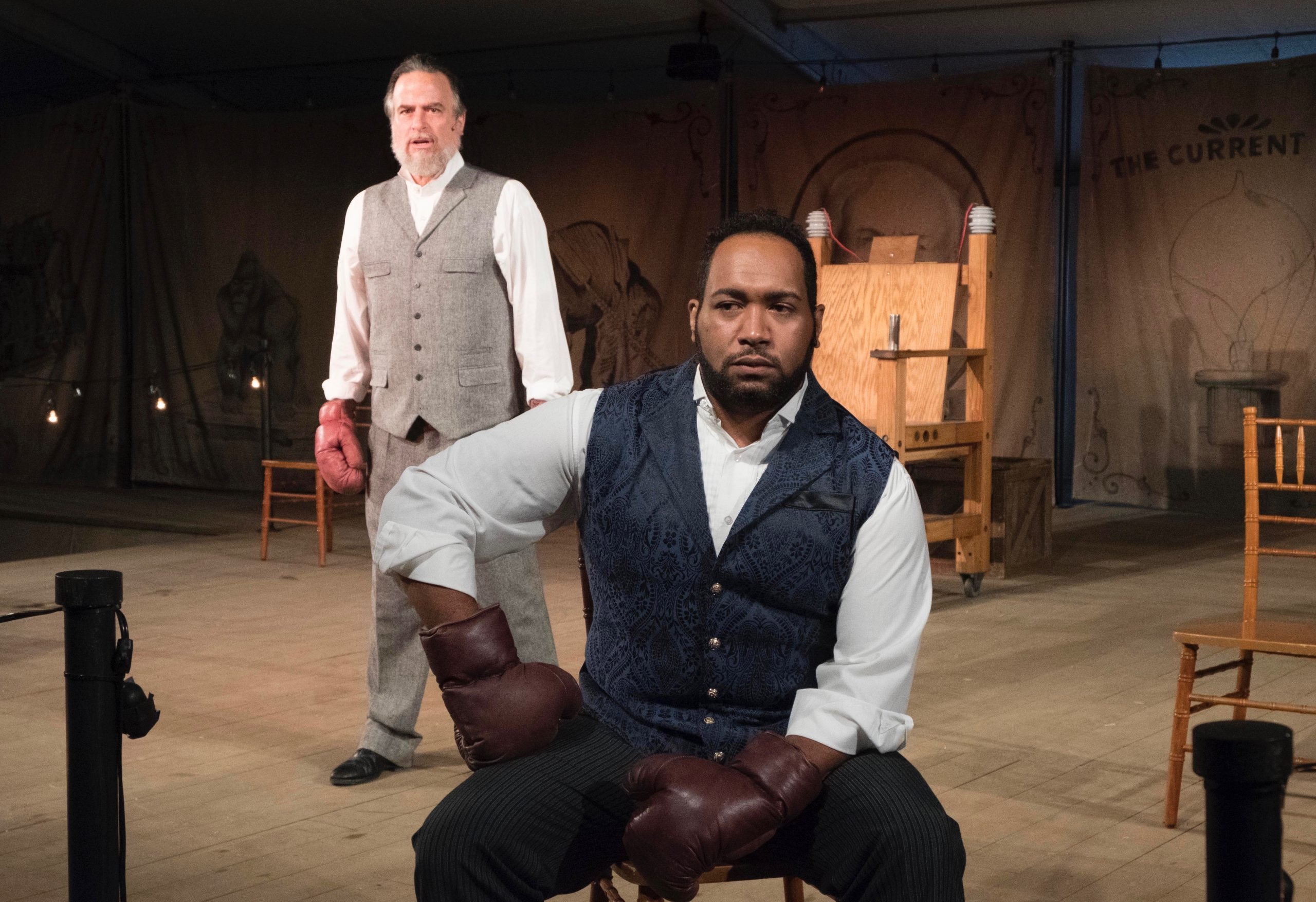 George Westinghouse—played by Billy Mason, front and center—contemplates his next move in 'The Current War' while Thomas Edison (Daniel Krell) hovers menacingly.