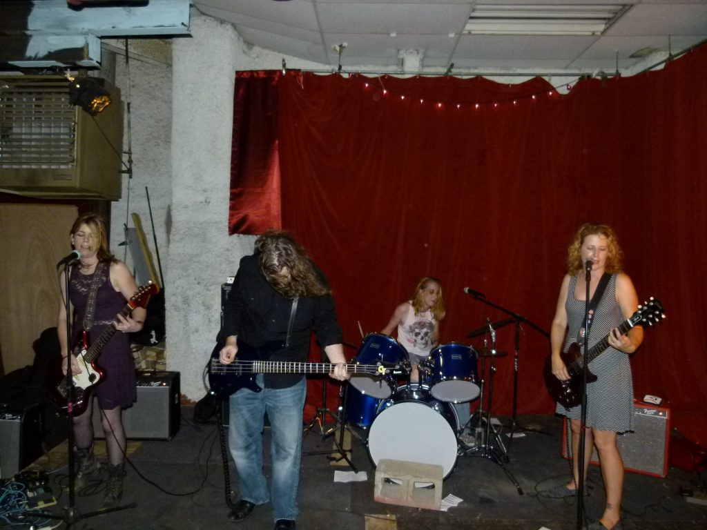 Stephanie Wallace (l.to r.), Jonathan Bagamery, Michele Dunlap, and Tammy Wallace perform at The Shop in Bloomfield as part of Ladyfest 2016.