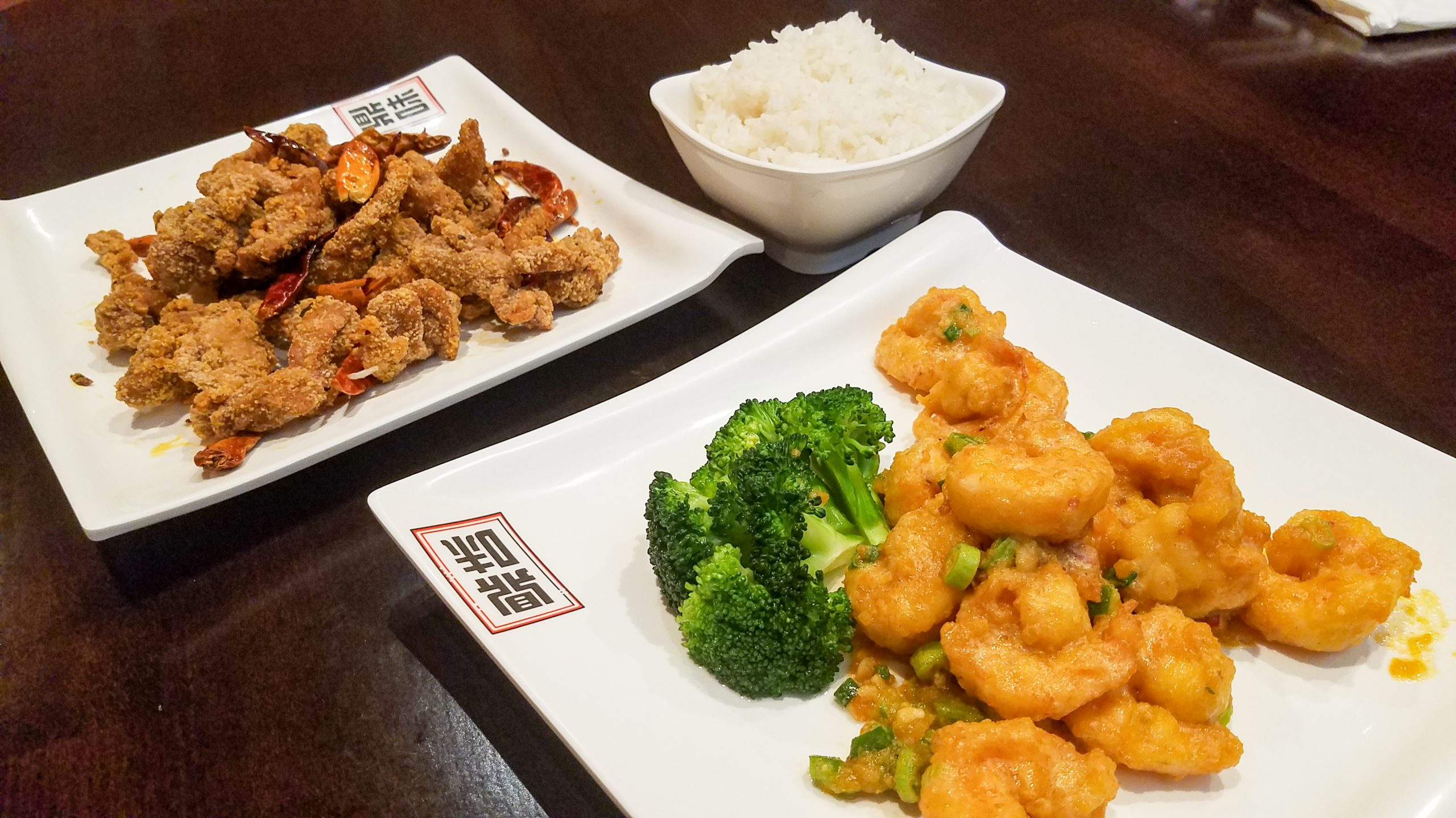 Taiwanese crispy chicken (l.) and prawn with duck eggs. (photo: Rick Handler)