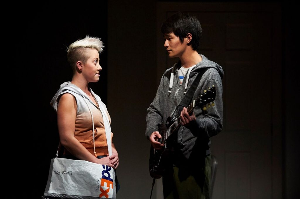 In City Theatre's production of Carla Chings's 'Nomad Hotel,' friends Alix (Katie Lynn Esswein) and Mason (Christopher Larkin) support one another during tough times. Photo: Kristi Jan Hoover.
