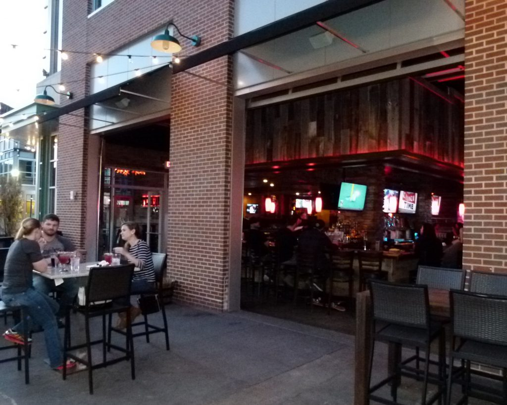 You don't have to be a cowboy or cowgirl to have fun at Tequila Cowboy. Several folks are enjoying the outdoor patio, while others congregate at the bar inside.