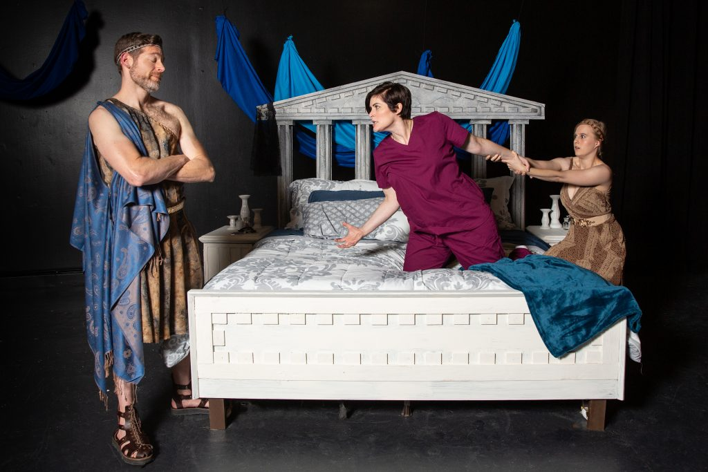 She's not really Medea, but sure looks like Medea raging at Jason while the Chorus restrains her in 'Not Medea' at off the WALL. Actors, L to R are Allan Snyder, Drew Leigh Williams, and Elizabeth Boyke. (photo: Mark Simpson Photography)
