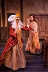 "In off the WALL's ""Or,"" Lady Davenant (Robin Abramson, masked) pays an unexpected—and amusing—visit to Aphra Behn (Erika Cuenca)."