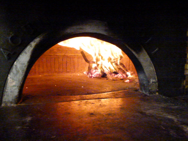 Interior photo of the wood burning oven.