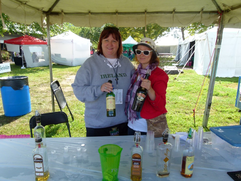 Friendly festival whiskey sellers Kim Smith (l.) and Svetlana Norman (r.) showcasing the offerings.