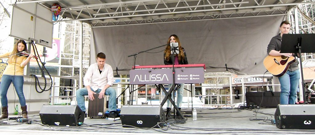 Allissa Logsdon and band performing at Paint the Square Green for Earth Day week in Market Square in 2018. (photo: Rick Handler)