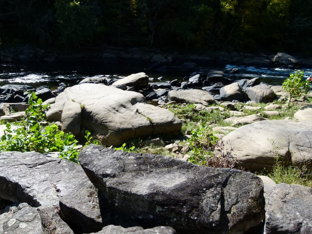 large boulders are numerous along the river banks.