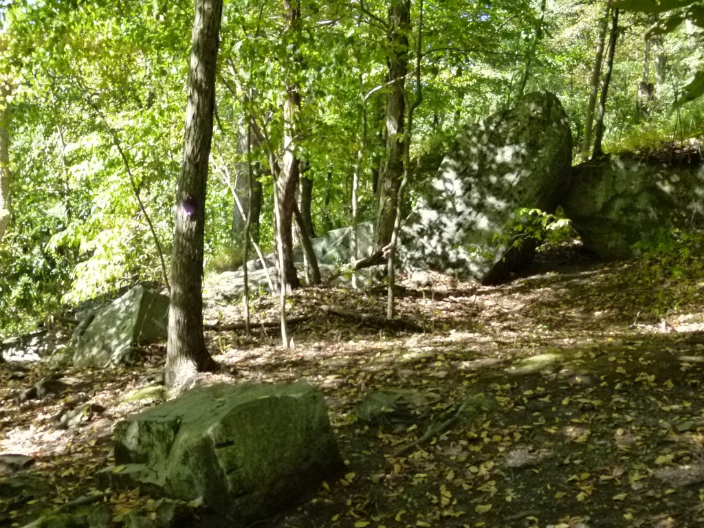 Looks like the endpoint for the trail unless you crawl under the two rocks or climb up and around them. To the left of the big rocks is a rocky slope that descends to the river.