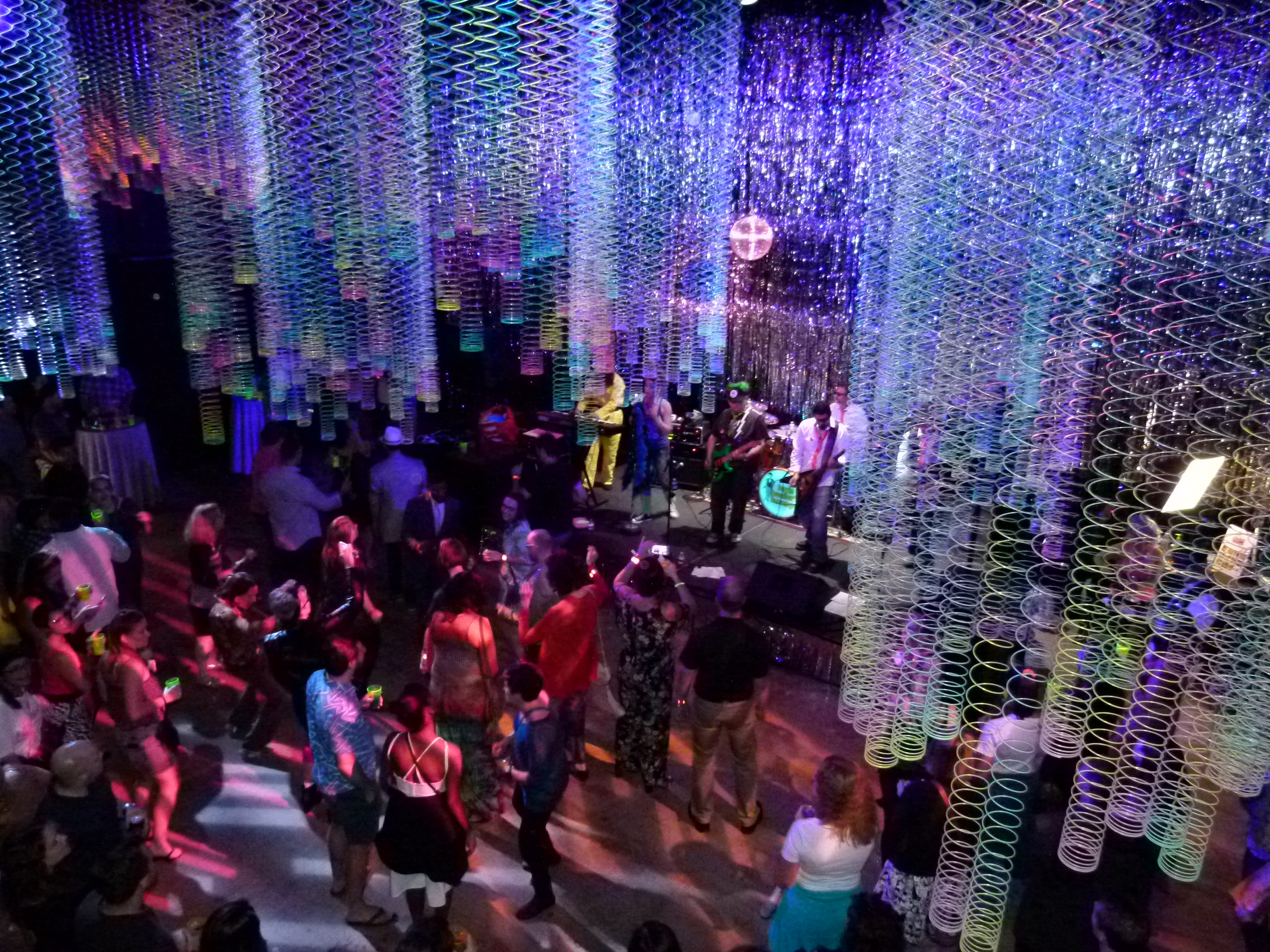 Ferris Bueller's Revenge! played the 80's room, which was creatively decorated with multi-colored Slinkys, as people danced.