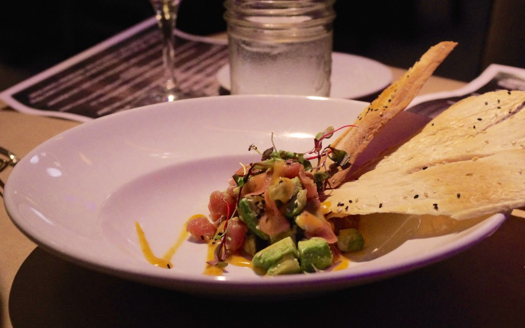 Tuna tartare with avocado, preserved radish and harissa orange mignonette, served with crunchy, peppery crackers.