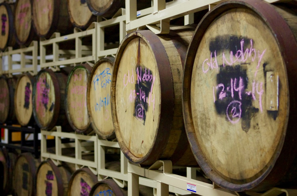Behind the scenes in the brewery, beer stacked in barrels.