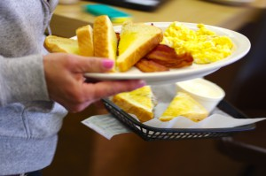 A popular breakfast choice being delivered: Eggs and bacon with Mancini's toast.
