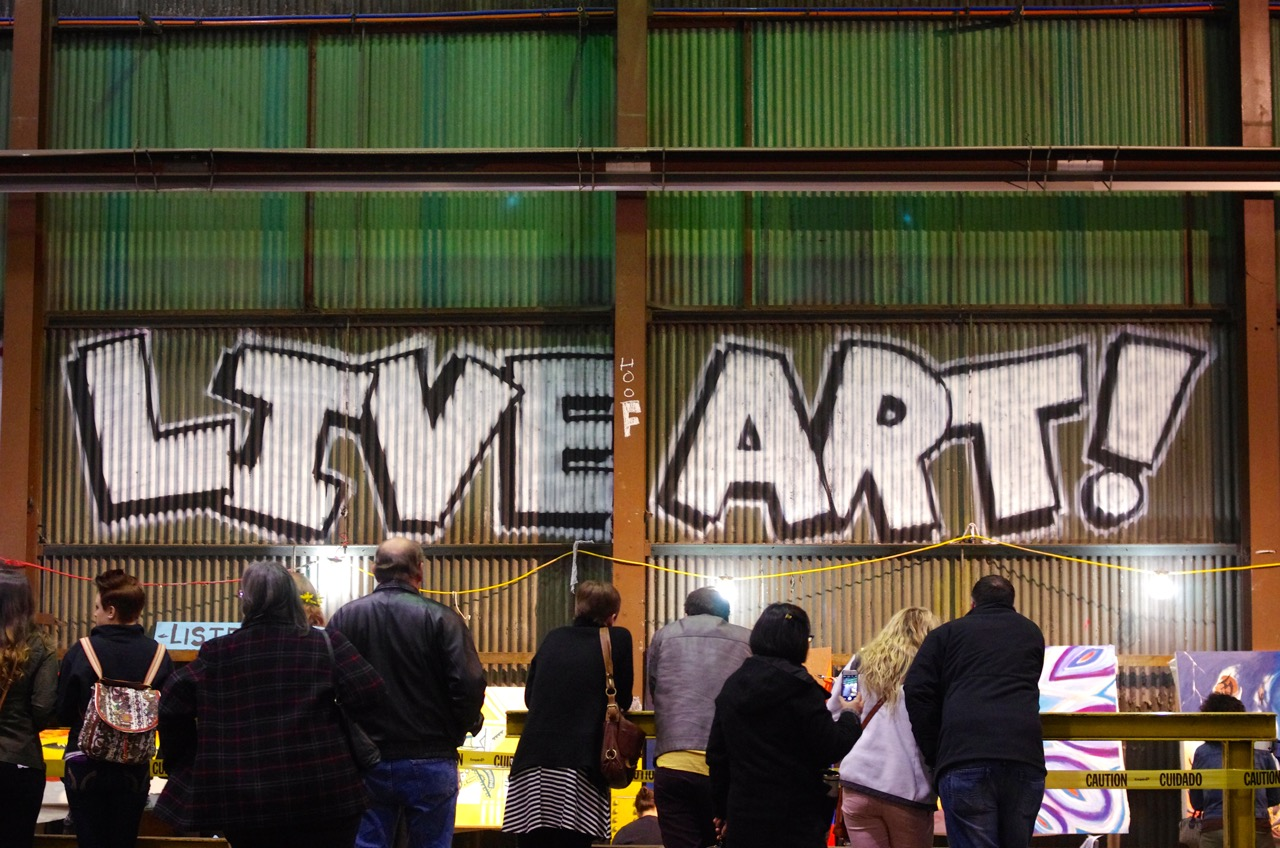 Visitors watch artists at work in the Live Art section of Art All Night.