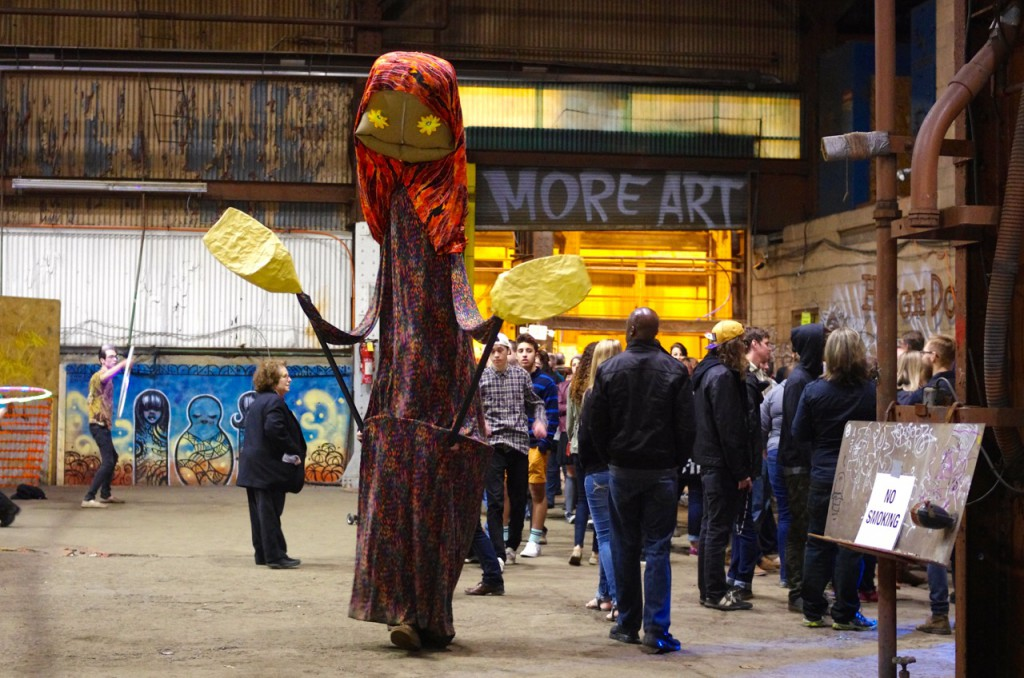 A stilt performer entertains crowds at Art All Night.