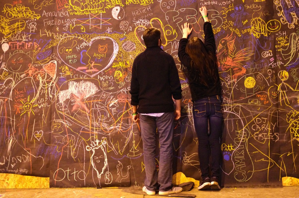 Visitors make their mark on the event with chalk.