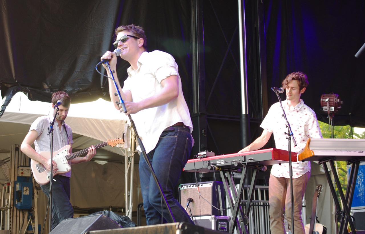 Vocalist Matt Bishop leans into the microphone on stage with Hey Marseilles.