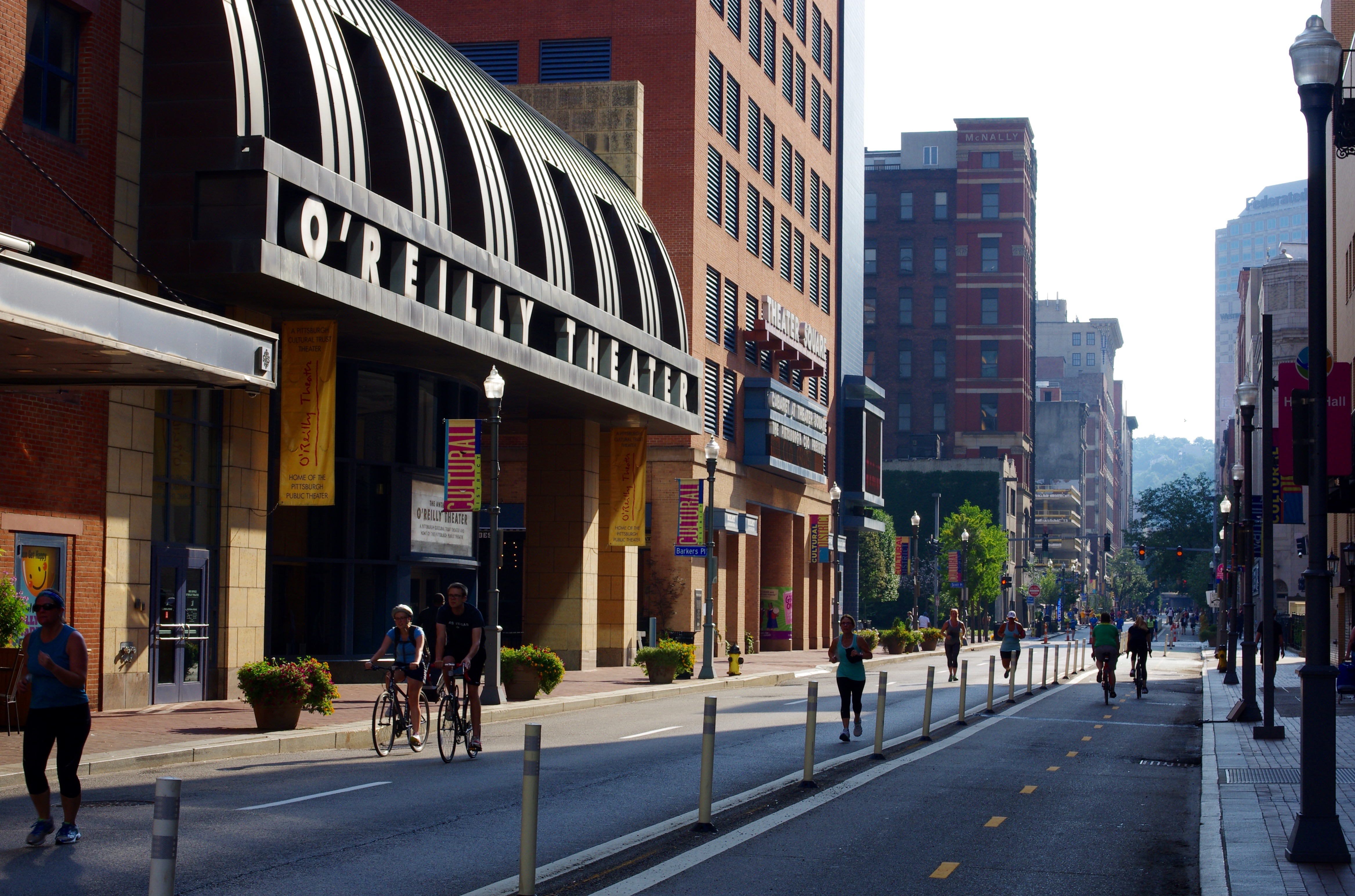 Runners approach the finish of a 5km running route in Downtown.