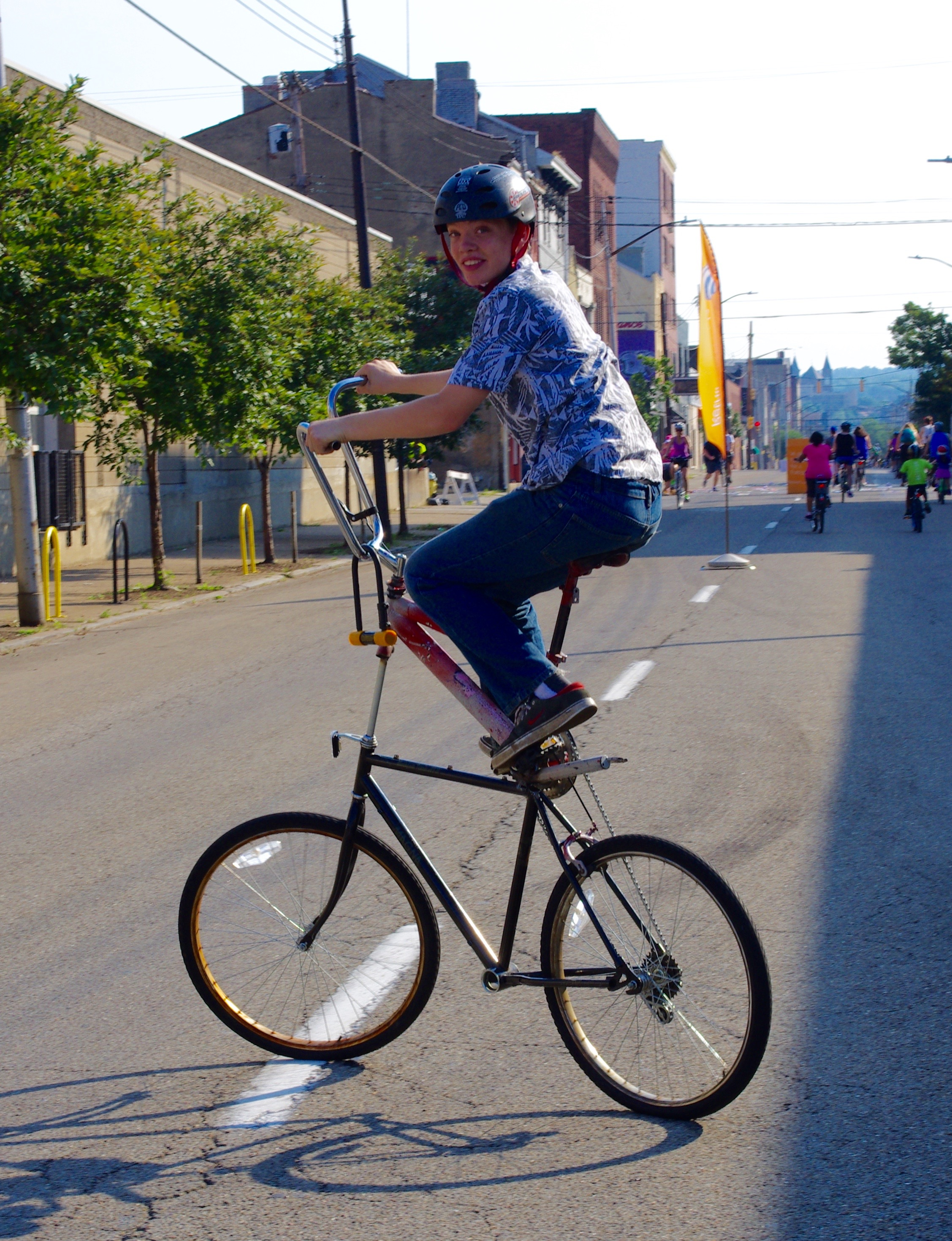 Linus Pietrusza, 16, riding his homemade tall bike, which puts a BMX frame on top of a mountain bike.