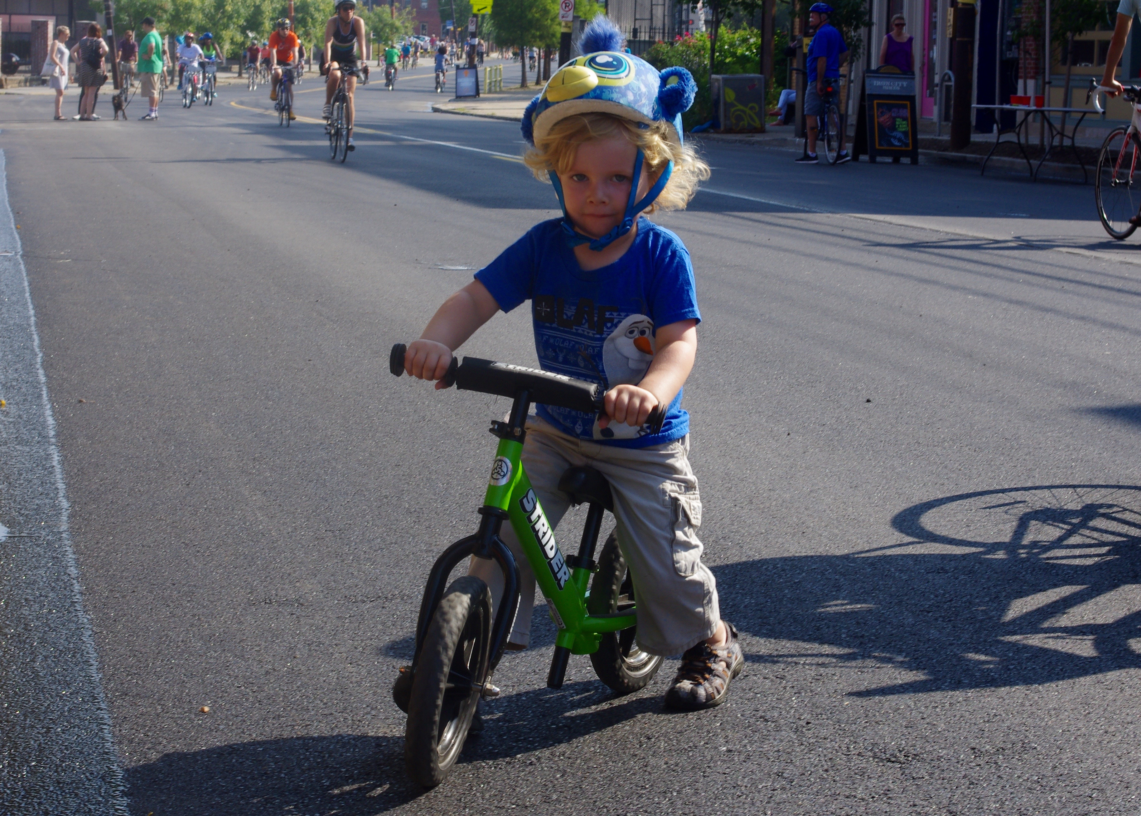 Three-year-old August Merriman-Preston is ready to ride on his Strider bike.