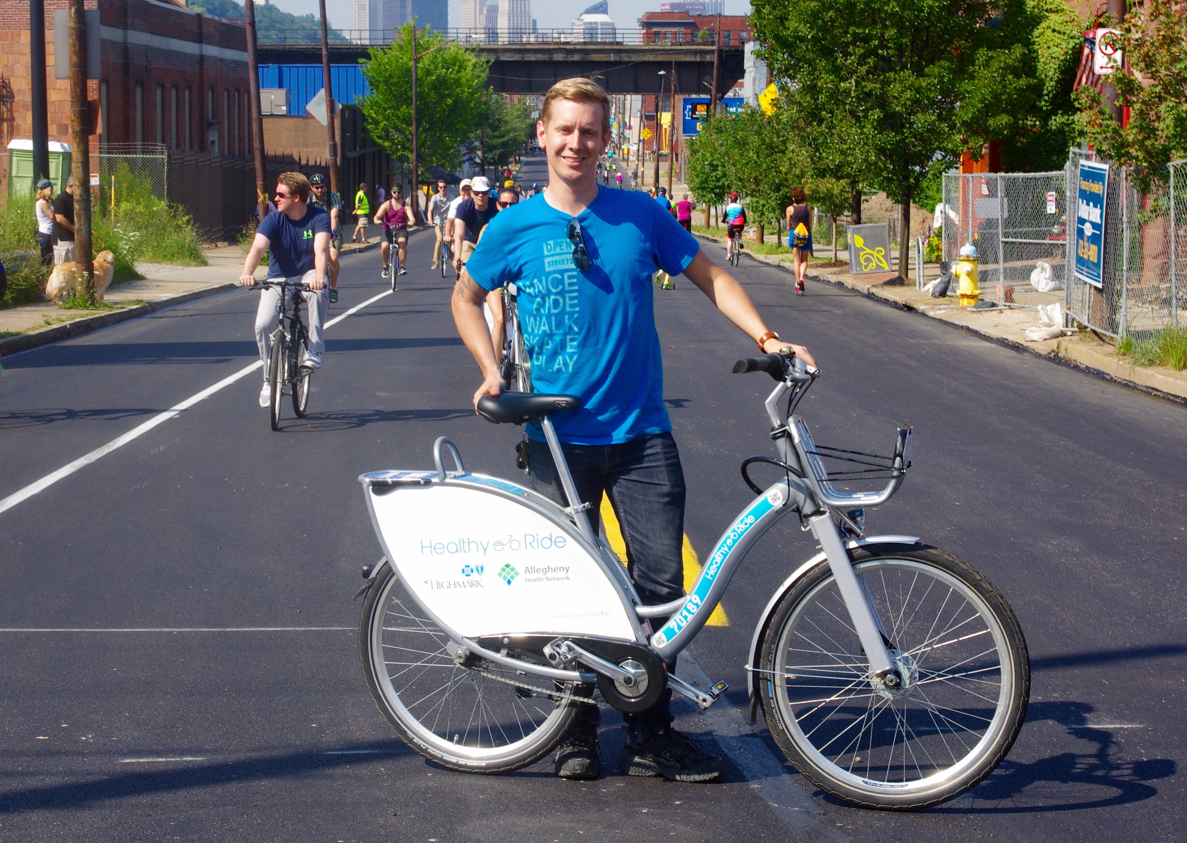 Mike Carroll, event manager for BikePGH, kept an eye on activities while riding a Healthy Ride bike share bicycle.
