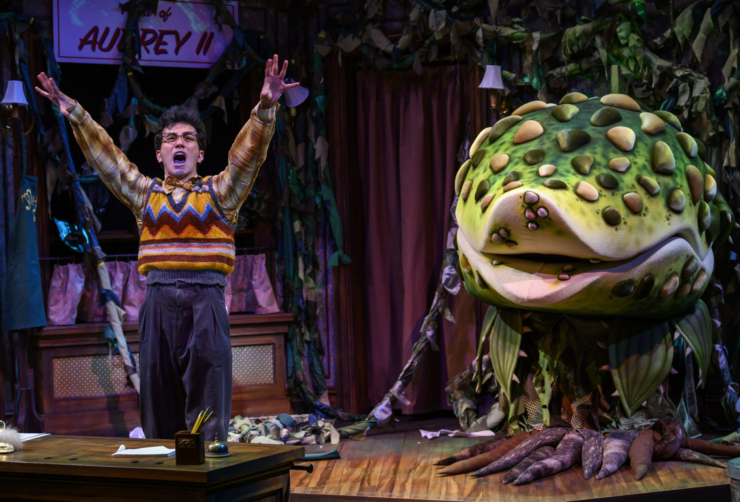 Seymour (Philippe Arroyo) and the carnivorous plant Audrey II in The Public's 'Little Shop Of Horrors. (photo: Michael Henninger)