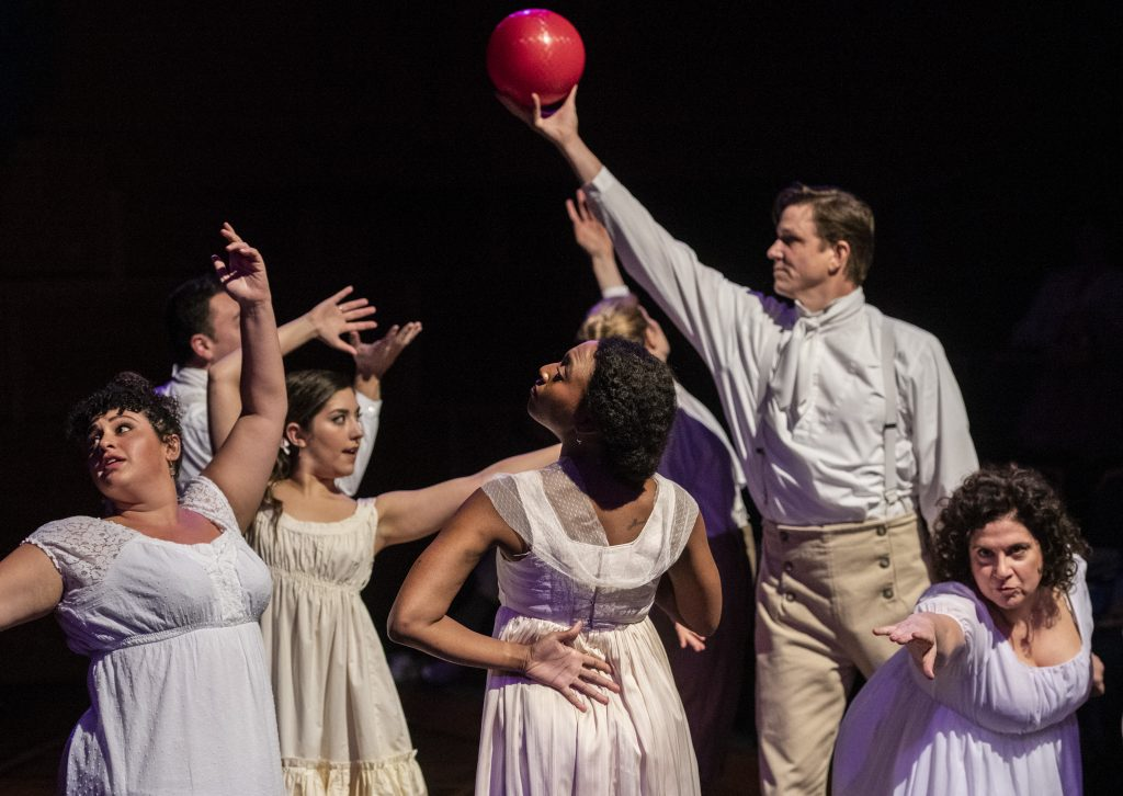Actor Andrew William Smith proudly holds the red ball high in his role as sister Mary in the The Public's 'Pride and Prejudice,' and who knows what the others are up to? (Photo: Michael Henninger)